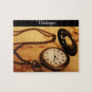 Fotografía del reloj de bolsillo del vintage en puzzle