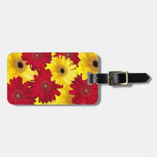 Fotografía roja y amarilla de la margarita de etiqueta para maletas