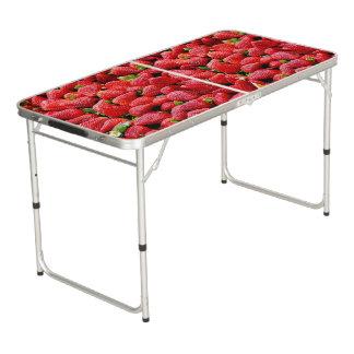 fotografía rosada oscura deliciosa de las fresas mesa de pong