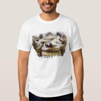 Fotos graduales de las magdalenas de la camisetas