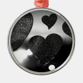 Four love hearts in silhouette night bokeh dof pho adorno navideño redondo de metal
