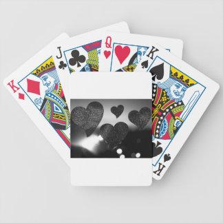 Four love hearts in silhouette night bokeh dof pho barajas de cartas