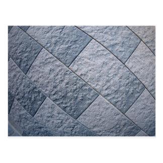 Fragmento de la pared decorativa gris postal