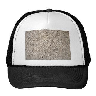 Fragmento de una pared hecha de pequeñas piedras gorras