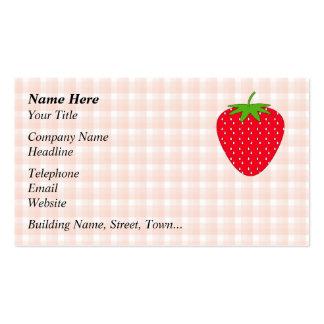 Fresa roja en control de la guinga tarjetas de visita
