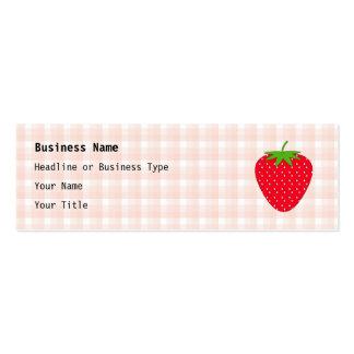 Fresa roja en control de la guinga tarjeta de negocio