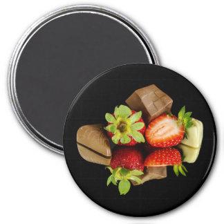 Fresas e imán redondo del chocolate