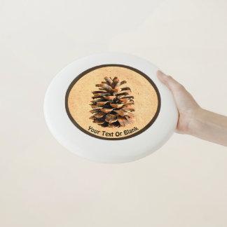 Frisbee De Wham-O Cono del pino en el papel