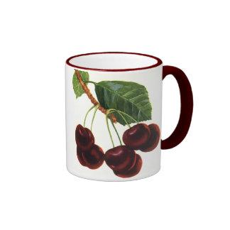 Fruta de la comida del vintage, cerezas en una taza a dos colores