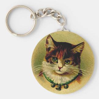 Gato de ojos verdes del vintage con los cascabeles llavero redondo tipo chapa