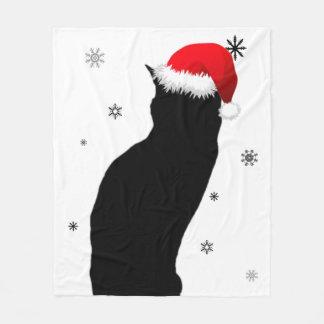 Gato del navidad con la manta del paño grueso y