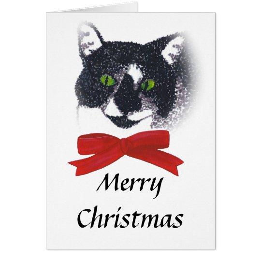 Gato del smoking con las tarjetas de Navidad rojas