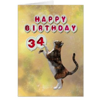 Gato juguetón y 34tos globos del feliz cumpleaños tarjeta de felicitación