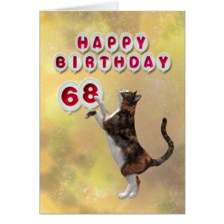 Gato juguetón y 68.os globos del feliz cumpleaños tarjeta de felicitación