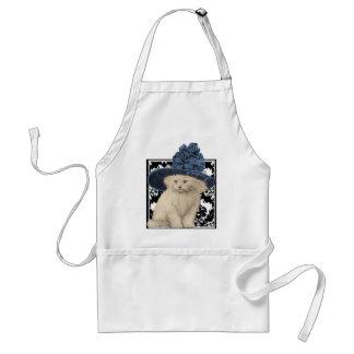 Gato lindo del vintage en delantal azul del gorra