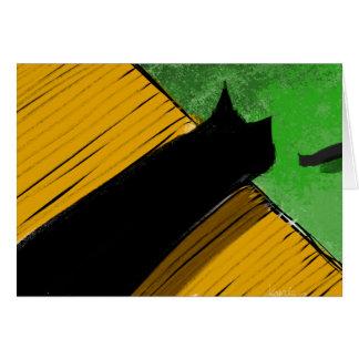 Gato negro en un tejado que mira sobre el borde tarjetas