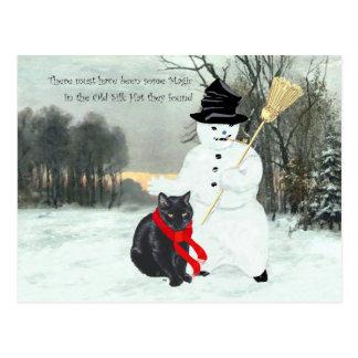 Gato negro y muñeco de nieve postal