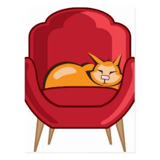 Gato que duerme en butaca postal