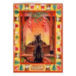 Gato que se sienta por la chimenea el Nochebuena Tarjetón