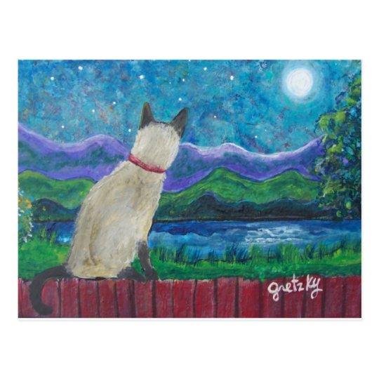 Gato siamés en la postal del claro de luna