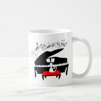 Gato y piano taza de café