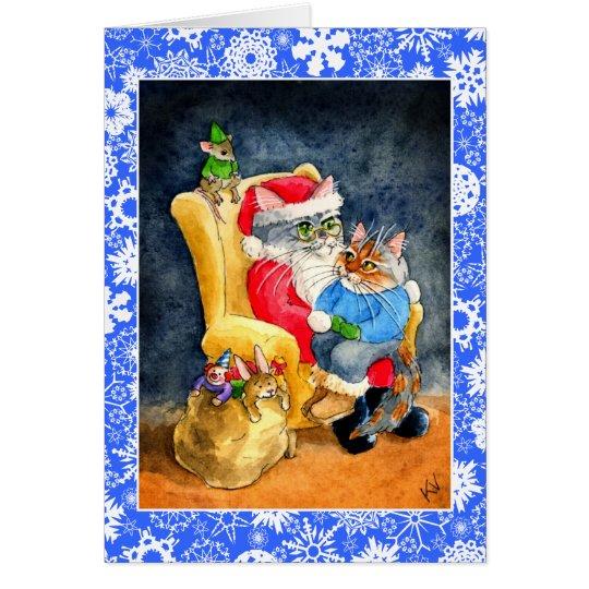 Gato y tarjeta del navidad o del día de fiesta de