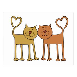Gatos lindos del dibujo animado con las colas postal