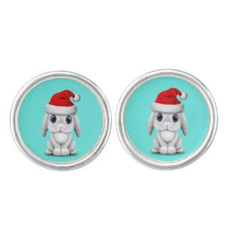 Gemelos Conejito blanco del bebé que lleva un gorra de