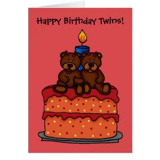 gemelos del chica en una tarjeta de la torta de