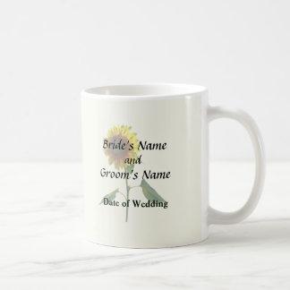 Girasol que coloca productos altos del boda taza de café