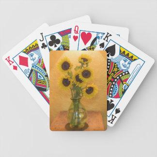 Girasoles en florero en el cuadro 2 barajas de cartas
