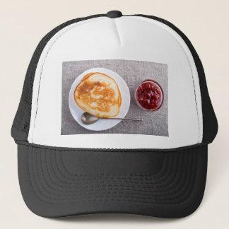 Gorra De Camionero Crepes y una taza de cristal con la mermelada de