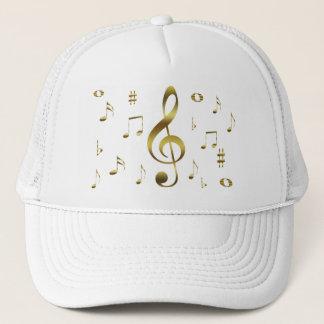 Gorra de las notas musicales del oro