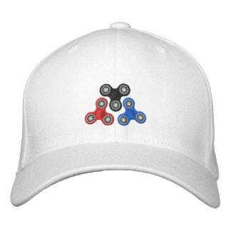 gorra del hilandero de la persona agitada
