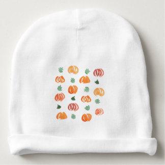 Gorrita tejida del bebé con las calabazas y las gorrito para bebe