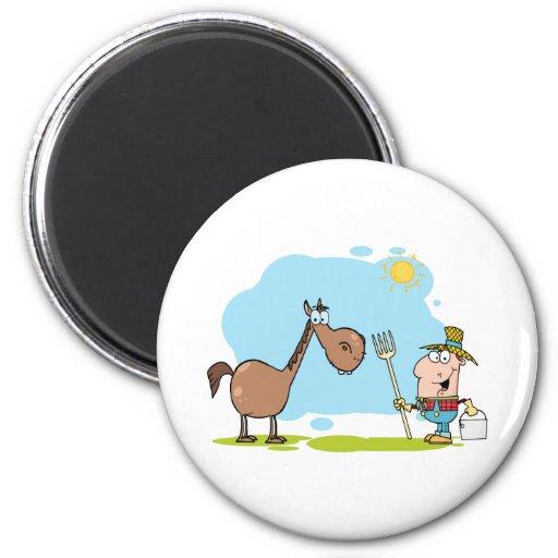 Granjero de sexo masculino con el caballo iman