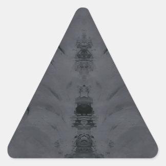 gris pegatina triangular