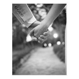 Groom holding hands with bride black and white postal