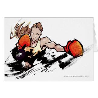Guante de boxeo de la mujer que lleva tarjeta de felicitación