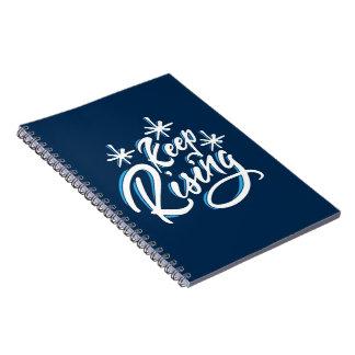 Guarde el cuaderno de levantamiento