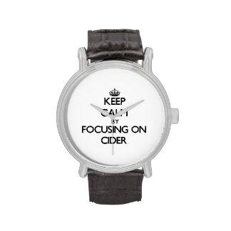 Guarde la calma centrándose en la sidra relojes de mano