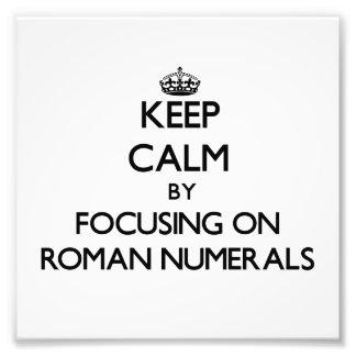 Guarde la calma centrándose en los números romanos fotografia