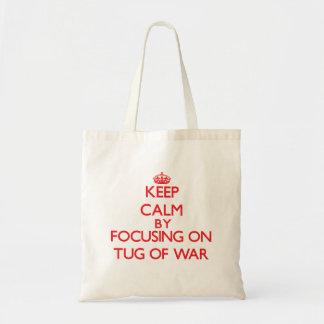Guarde la calma centrándose encendido en esfuerzo bolsas lienzo