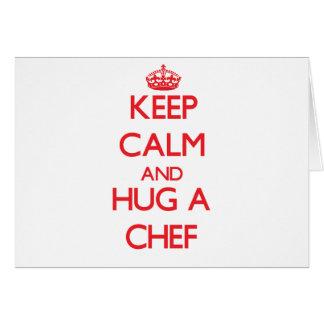 Guarde la calma y abrace a un cocinero tarjeta