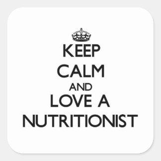 Guarde la calma y ame a un nutricionista pegatina cuadrada