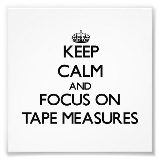 Guarde la calma y el foco en cintas métricas foto