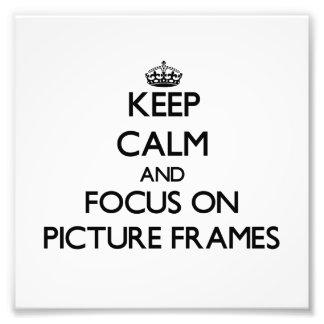 Guarde la calma y el foco en marcos foto