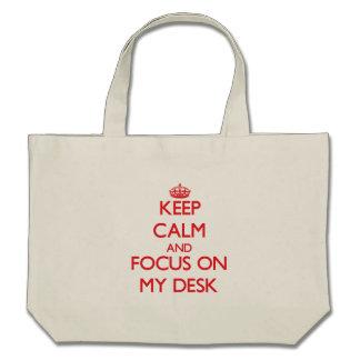 Guarde la calma y el foco en mi escritorio bolsa