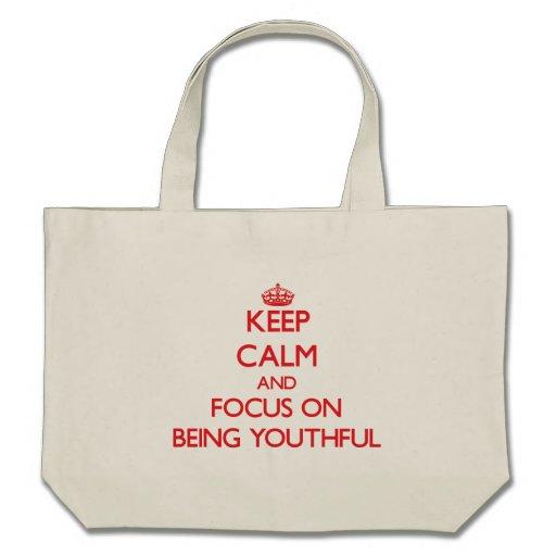 Guarde la calma y el foco en ser joven bolsas de mano