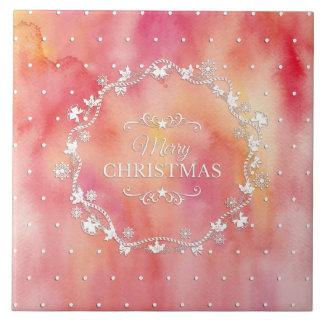 Guirnalda del navidad en las baldosas cerámicas de